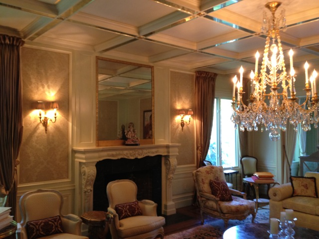 Hand glazed wall panels, built in ceiling beams with gold leaf and inserted mirrors.