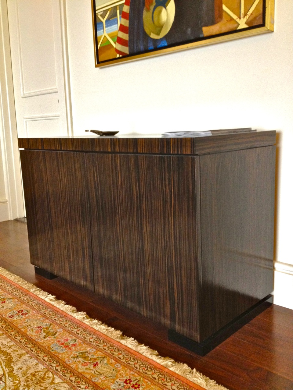 Ebony Macassar buffet with high gloss black lacquered